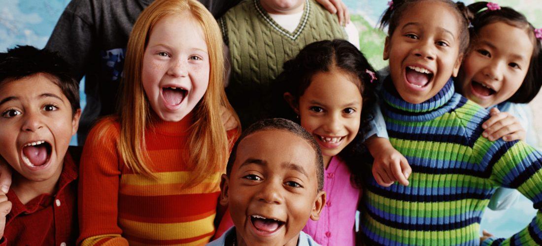 School children (8-10) in front of map
